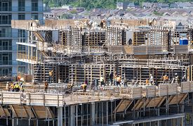 Mississauga, Canada - June 11, 2019: Construction Workers Building A High Rise Condominium On A Sunn