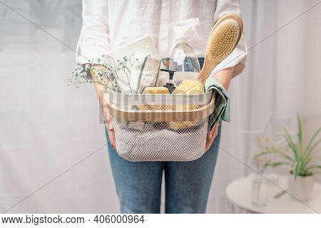 Woman Holding Basket With Cleaning Equipment. A Woman Is Doing Spring Cleaning. The Concept Of House