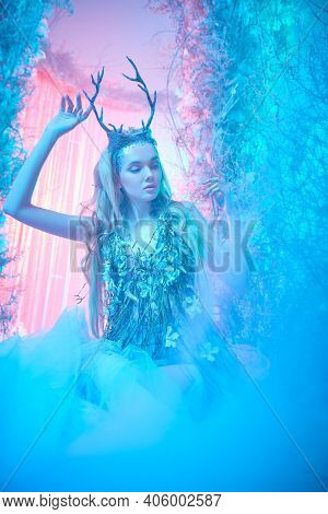 Fantasy world. Beautiful forest nymph in a fabulous winter forest.