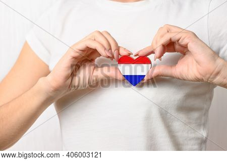 Love Luxembourg. The Girl Holds A Heart In The Form Of The Flag Of The Luxembourg On Her Chest. Luxe