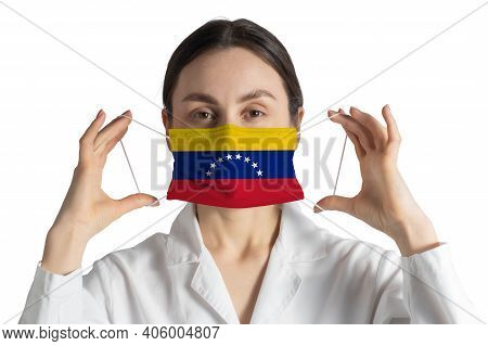 Respirator With Flag Of Venezuela Doctor Puts On Medical Face Mask Isolated On White Background