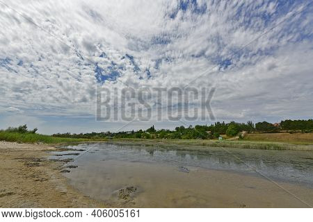 Landscapes Of The Sandy Beach Of The Azov Sea, Small Bays And Breakwaters, Primorsk.