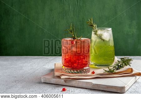 Two Colorful Summer Cocktails In Glasses On Grey Table. Assortment Of Fresh Summer Drinks. Red Sangr