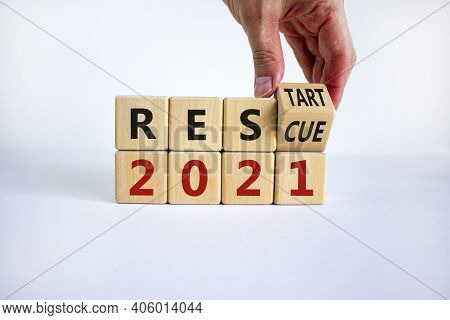 2021 Rescue And Restart Symbol. Businessman Hand Turns Cubes And Changes The Word '2021 Rescue' To '