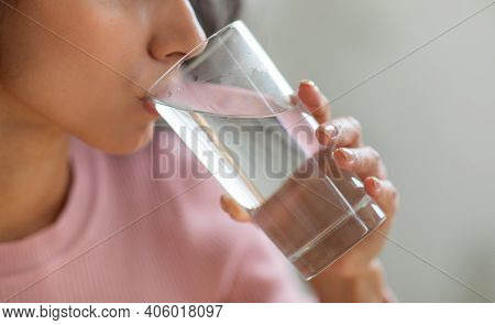 Healthy Liquid. Unrecognizable Young Lady Drinking Clean Mineral Water From Glass At Home, Thirsty B