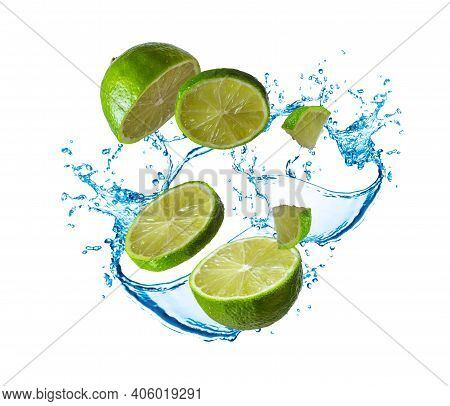 Flying Food Concept. Juicy Lime. Splashing Water And Crushed Lime In Motion Isolated On White. Halve