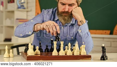 More Than Only Chess. Bearded Man Training For Chess Competition. Chess Figures On Wooden Board. Foc