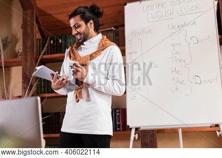 Online Teaching Concept. Indian Teacher Guy Having Web Class Explaining English Language Rules To We