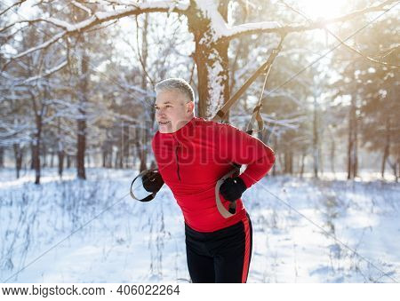 Functional Training. Portrait Of Fit Senior Man In Sportswear Doing Exercises With Trx Fitness Strap