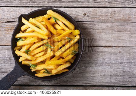 French Fries With Rosemary And Ketchup . Fastfood Background