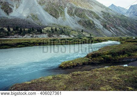 Autumn Scenery With Azure Milky Mountain River And Rich Vegetation. Atmospheric Autumn Alpine Landsc