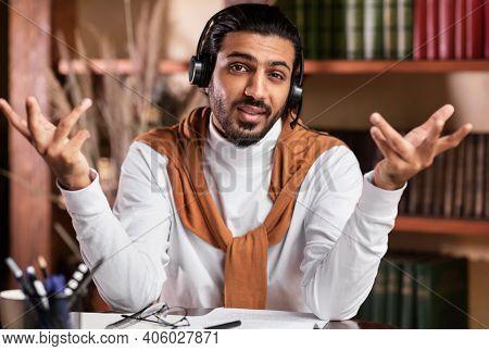 E-teaching. Young Arab Teacher Teaching Online Talking To Camera Wearing Headset Having Virtual Lect