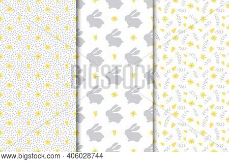 Set Of Seamless Easter Patterns. Varied Flowers Leaves And Rabbits In Gray And Yellow On A White Bac