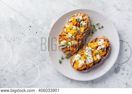 Baked Pumpkin Sandwich With Dorblu Cheese With Blue Mold, Honey And Thyme On A Concrete Old Light Ba