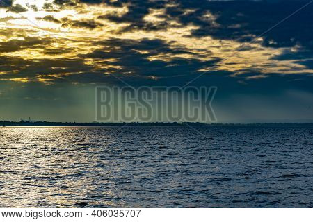 Impressive Panorama On The Lake At Sunset With Clouds.