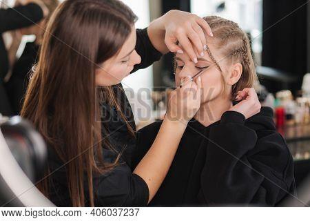 Makeup Artist Work With Beautiful Blond Hair Model In Studio Until Camera Films Process Of Makeup. B