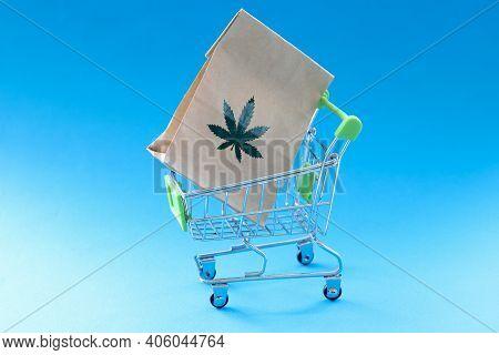 Paper Bag With Marijuana Herb Lying In Metal Shopping Basket. Illegal Sale Of Marijuana Concept