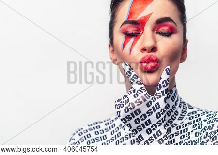 Portrait of a beautiful girl with make-up on a white background