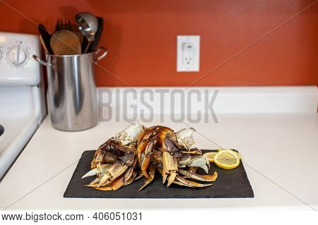 Raw, Cleaned, Uncooked Dungeness Crab Legs Sit On A Platter In The Kitchen Ready To Be Cooked For Di