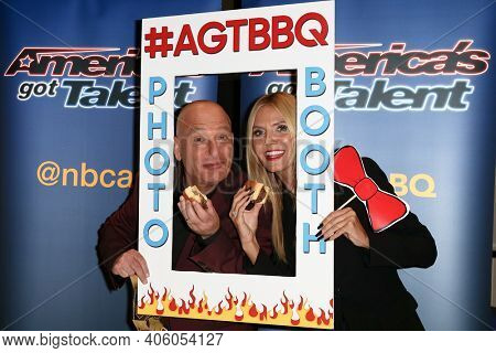 NEW YORK-SEP 2: Model Heidi Klum (L) and Howie Mandel attend the America's Got Talent Season 10 Live Barbeque and Viewing Party on September 2, 2015 in New York City.