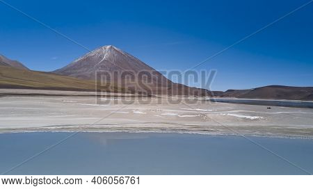 Aerial With Stunning View Of Laguna Verde At The Foot Of Licancabur Volcano, In The Altiplano Of Bol