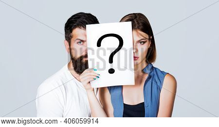 Couple Holding Paper Question Mark. Anonymous, Man And Woman Question, Incognita. Problems And Solut