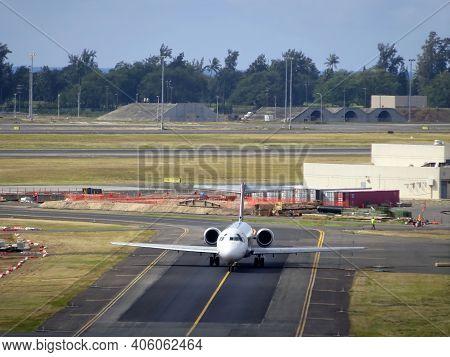 Honolulu - January 23, 2015: Aerial Of Airplane Driving Down The Runway At Honolulu International Ai
