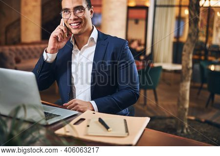 Attractive Joyous Businessman Calling On His Cellphone