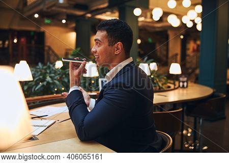 Joyous Male Entrepreneur Communicating On His Smartphone
