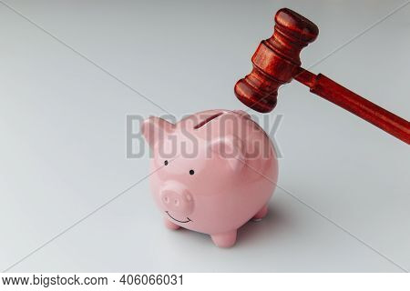 Judge Wooden Gavel And Pink Piggy Bank On A White Background. Loan And Business Concept