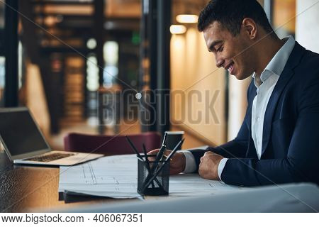 Joyous Architect Working On A New Building Plan