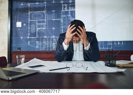 Employee Having A Bad Headache At Work