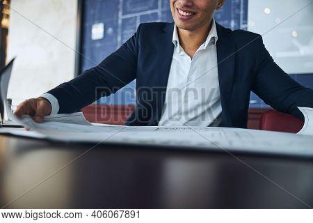 Joyous Male Architect Analyzing A Technical Drawing