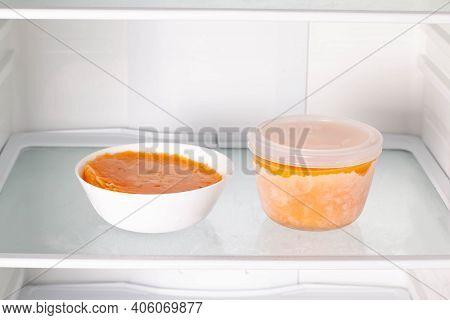 Frozen Pumpkin Soup In The Refrigerator. Frozen Food. Frozen Soup. Preparing Food For The Week