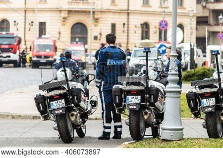 Police Agent On Motorcycle, Romanian Police (politia Rutiera) Car Patrolling Streets To Avoid Curfew