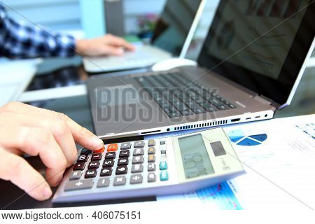Businessman / Accountant Is Doing Calculations. Tax Season