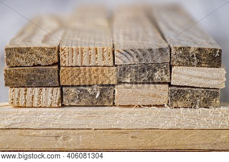 Stacked Raw Planks. Material For Use In A Carpentry Workshop.
