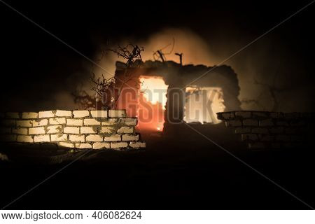 Old Stone House Burning Uncontrollable In The Night. A Fire In A Country House. Creative Artwork Dec
