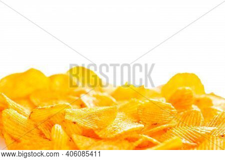 A Foreground Of Grooved Fried Potato Chips That Fades Into A Smooth Blur On A White Background, Blan