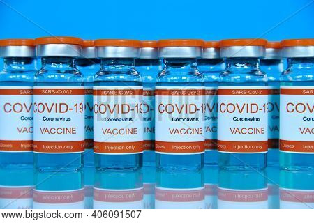 Ampoules With Covid-19 Vaccine On A Laboratory Glass Table. Medicine And Corona Virus Infection Conc