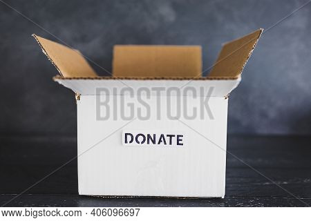 Charity Donation And Decluttering, Empty Box With Donate Label Ready To Be Filled With Second-hand I