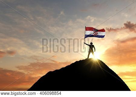 Croatia Flag Being Waved At The Top Of A Mountain Summit. 3d Rendering