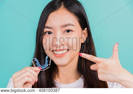 Female Hold Teeth Retaining Tools After Removable Braces, Portrait Young Asian Beautiful Woman Smili
