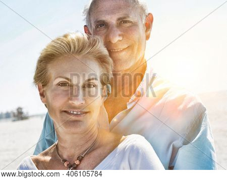 Portrait of senior couple showing affection by the beach