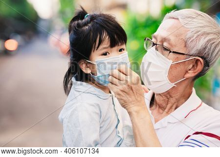 Family Wearing Medical Face Mask. Children Are Uncomfortable With Wearing Masks. Grandfather Lovingl
