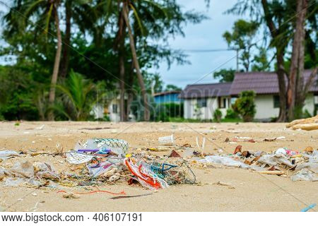 Pollutions And Garbages On The Sand Beach