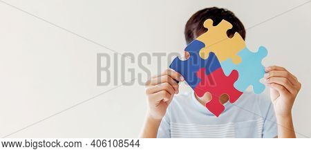 Kid Boy Hands Holding Puzzle Jigsaw,  Mental Health Concept, World Autism Awareness Day