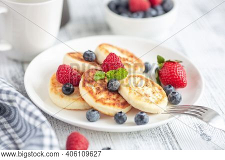 Cottage Cheese Pancakes With Fresh Berries On White Wooden Table. Breakfast Or Lunch. Syrniki - Imag