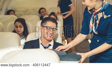 Cabin Crew Give Service To Passenger In Airplane . Airline Transportation And Tourism Concept.