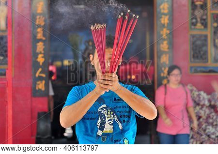Jakarta, Indonesia - February 9, 2013: People With Burner Incense In Hand Pray At Jin De Yuan Temple